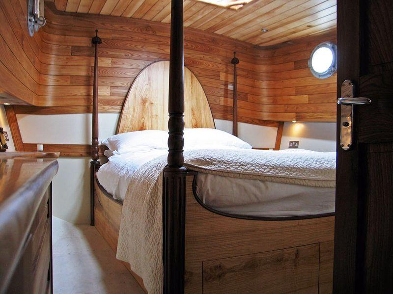 Four poster bed on dutch barge